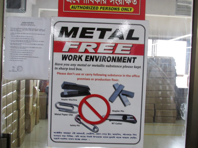 Safety standards also seemed to upheld in compliance factories. For example, see the above sign indicating a metal free work environment.